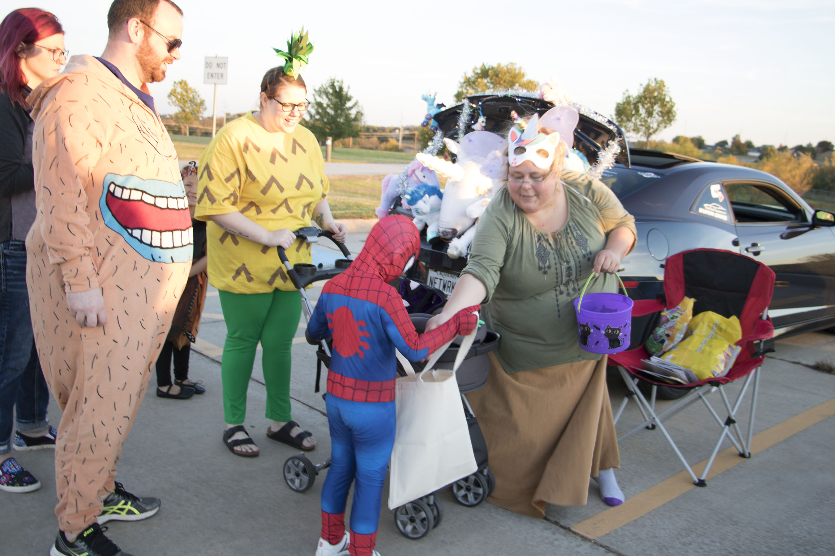 Volunteer hands out candy