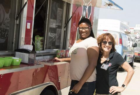 Visitors purchase food from food truck