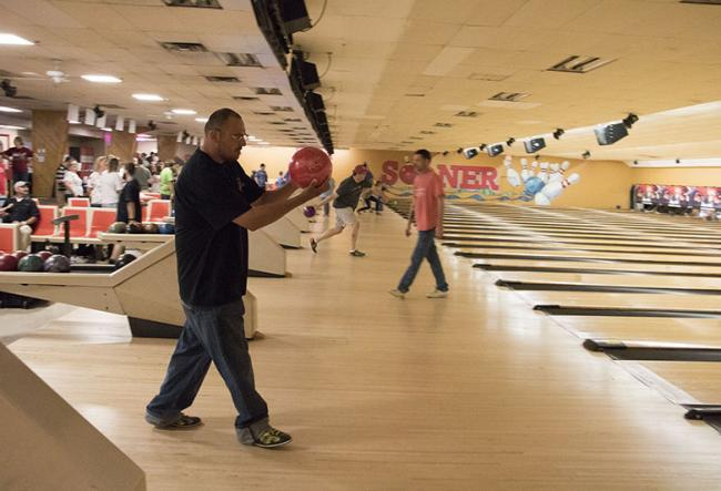 Man bowling at event
